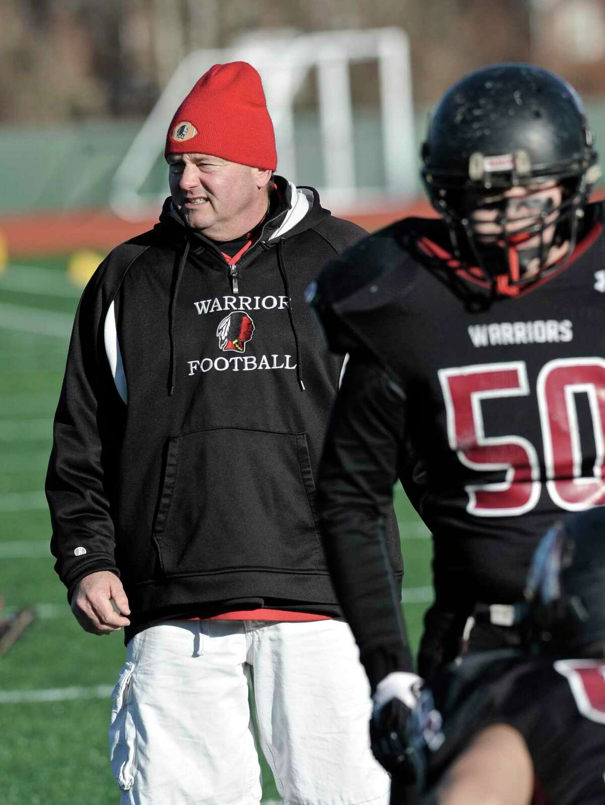Valley Regional's head coach Tim King watches his team warmup before the Connecticut Class S Large state football championship game between Valley Regional/Old Lyme and Ansonia high schools, on Saturday, December 13, 2014, played at Veterans memorial Stadium, in New Britain, Conn.