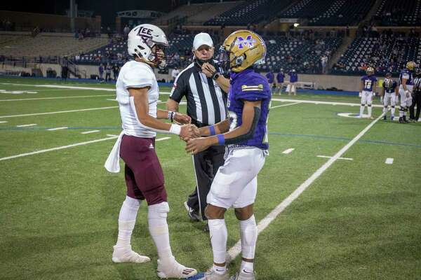 Lee's Mikey Serrano and Midland High's Daniel Garcia shake hands after the coin toss Friday, Nov. 20, 2020 at Grande Communications Stadium. Jacy Lewis/Reporter-Telegram