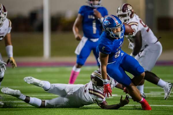 Bruins' Jordan Guidry (6) breaks away from a defender for extra yards in the first half. The West Brook Bruins took on the the Bulldogs of Summer Creek Friday night at BISD Memorial Stadium. Photo made on November 20, 2020. Fran Ruchalski/The Enterprise