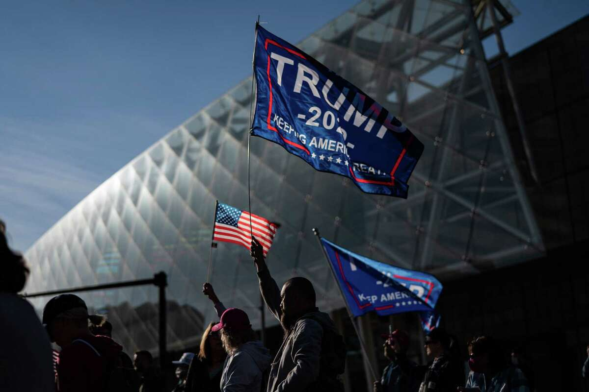 Donald Trump supporters protest the presidential vote count outside the TCF Center in Detroit on Nov. 6. Despite no evidence, the president and his allies are alleging that large, majority Black cities like Detroit, Atlanta, Philadelphia and Milwaukee are hotbeds of voter fraud.