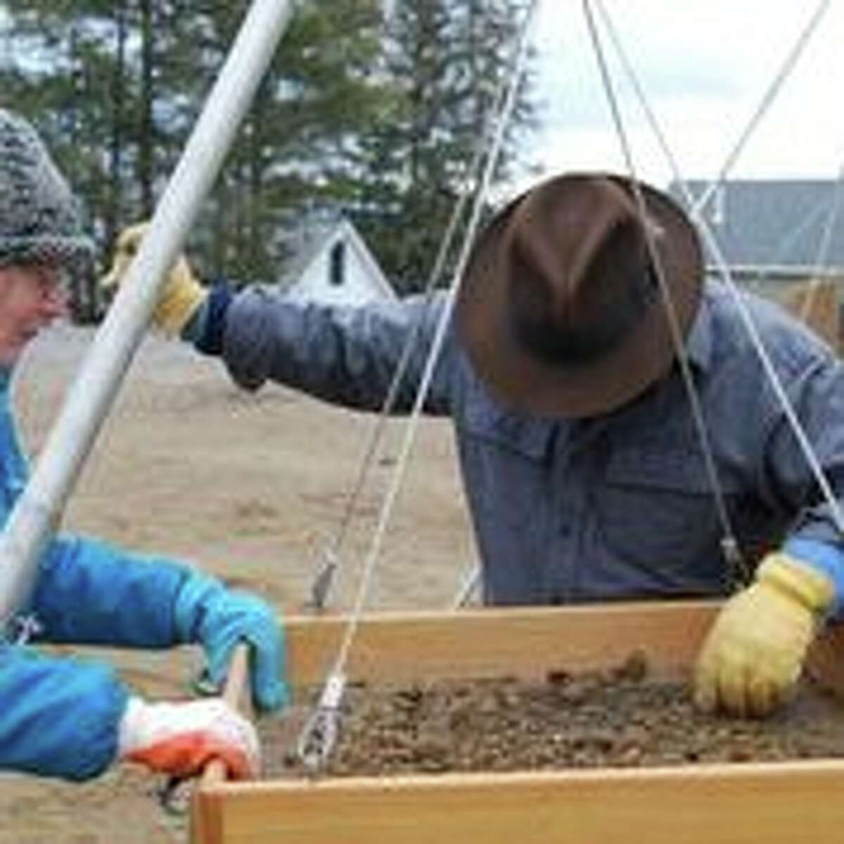 Lyn Karig Hohmann and Charles Vandrei sift for artifacts and 18th-century human remains, discovered during a construction project on Courtland Street in the village of Lake George. (Photo courtesy of Lisa Anderson)