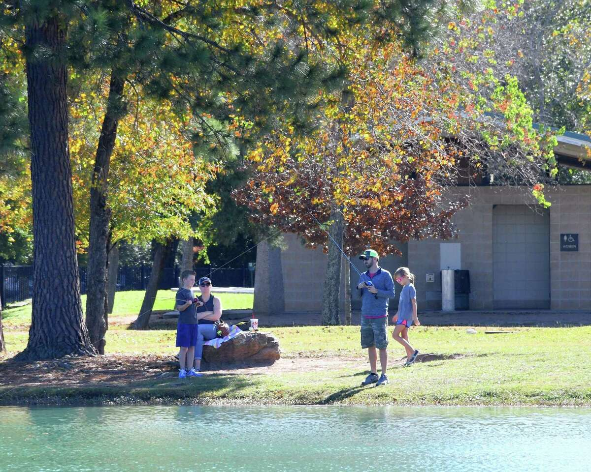 The Palermo Family of Katy enjoys some fishing at Mary Jo Peckham Park in Katy on Saturday, December 1, 2018. The pond is regularly stocked with trout by Texas Parks & Wildlife during the winter months.