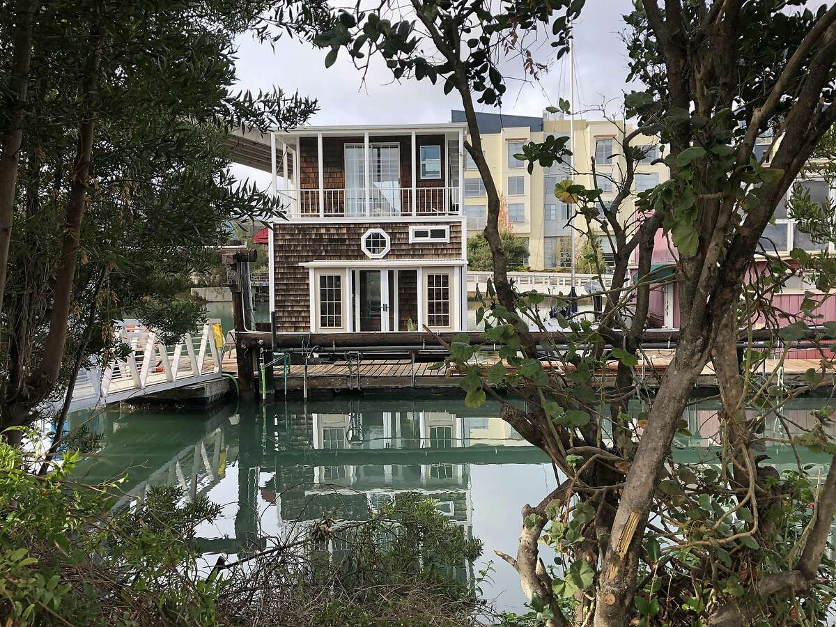 The houseboat Moonlight is a picturesque sight from across Mission Creek. In bygone days, the creek had a less-than-picturesque nickname because of pollution from raw sewage.