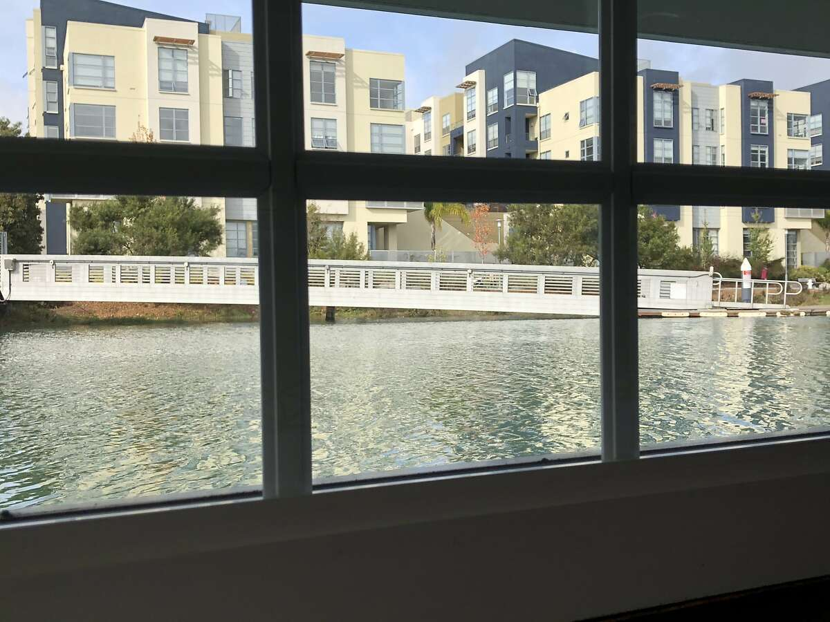 The interior of the houseboat Moonlight offers a view of gleaming new housing that has sprouted on the north bank of Mission Creek.