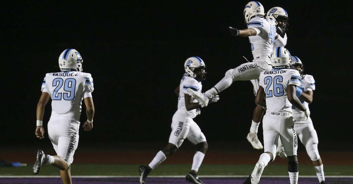 Paetow Panther special teams player Sultan Bakare (49) celebrates his on-sides kick return for a touchdown against the Angleton Wildcats in the second quarter on November 20, 2020 at Angleton Wildcat Stadium in Angleton, TX.
