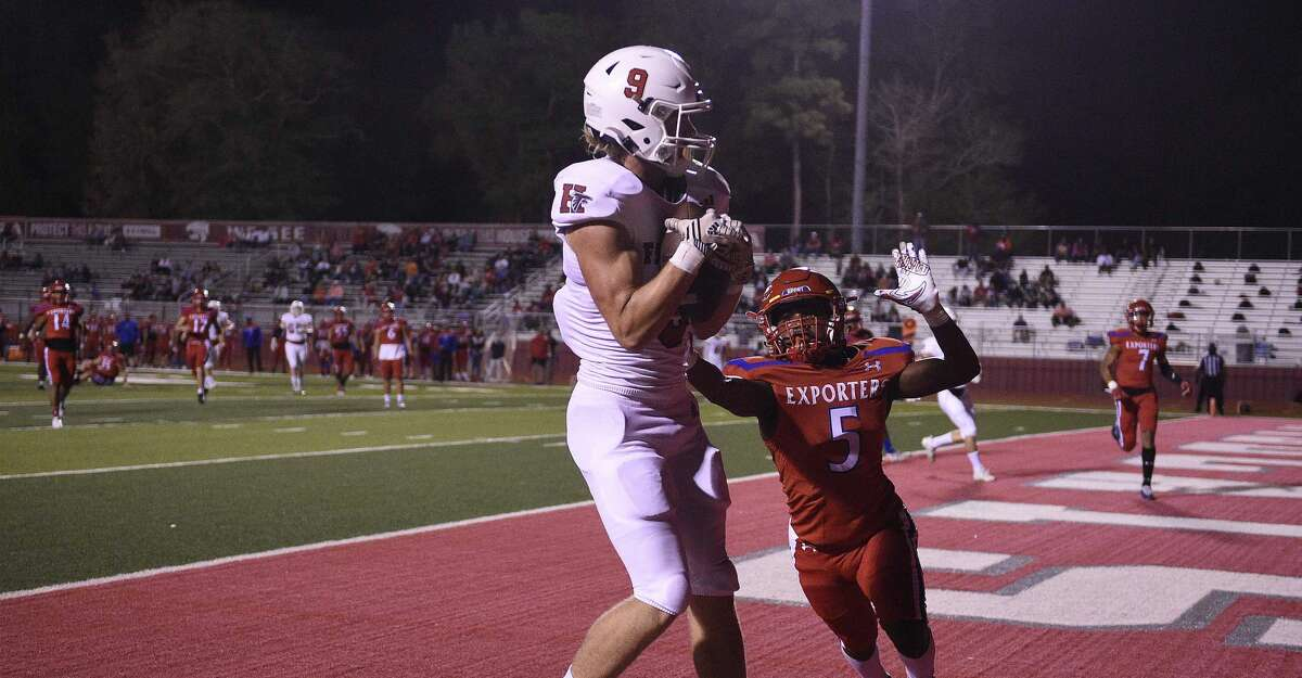 Huffman wide receiver Gunnar Gates (9) catches a touchdown pass as Brazosport defensive back Quinton Wright defends during the first half of a 4A Division I Region III high school football playoff game, Friday, Nov. 20, 2020, in Splendora, TX.