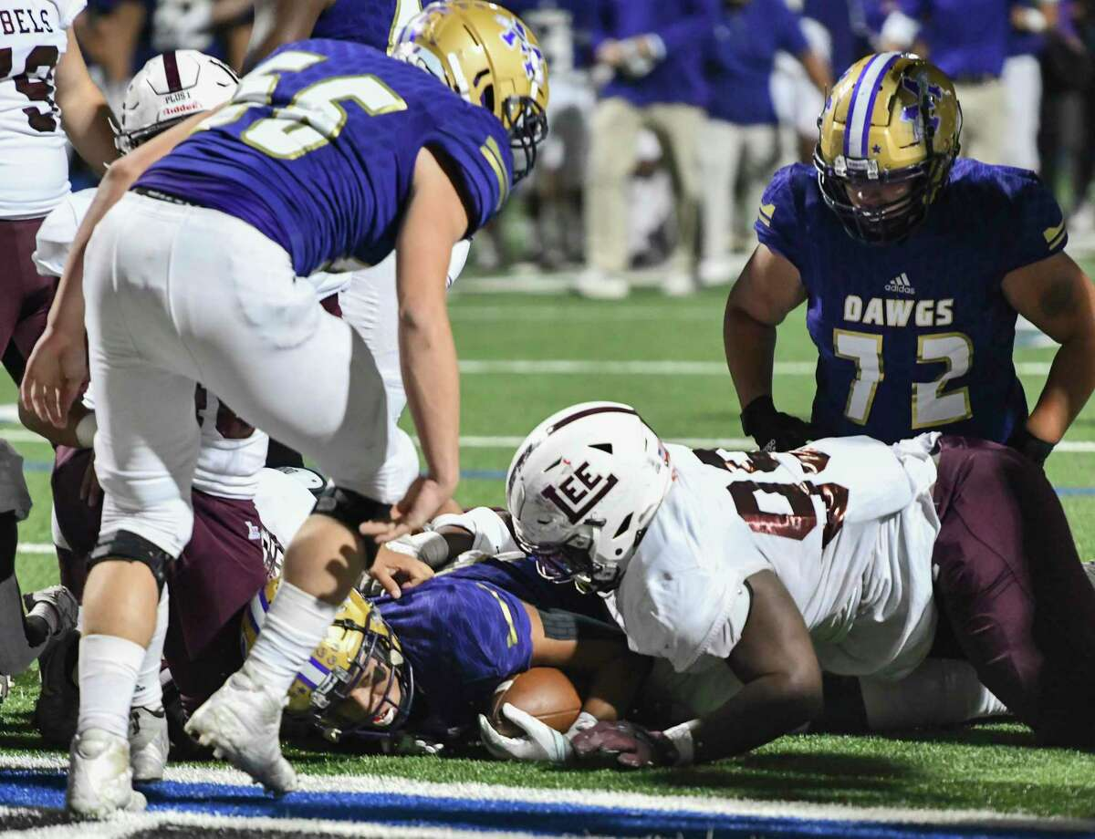 Midland High's Jacob Smith is brought down short of the endzone by Lee's Kameron Curry (99) on Friday, Nov. 20, 2020 at Grande Communications Stadium. Jacy Lewis/Reporter-Telegram