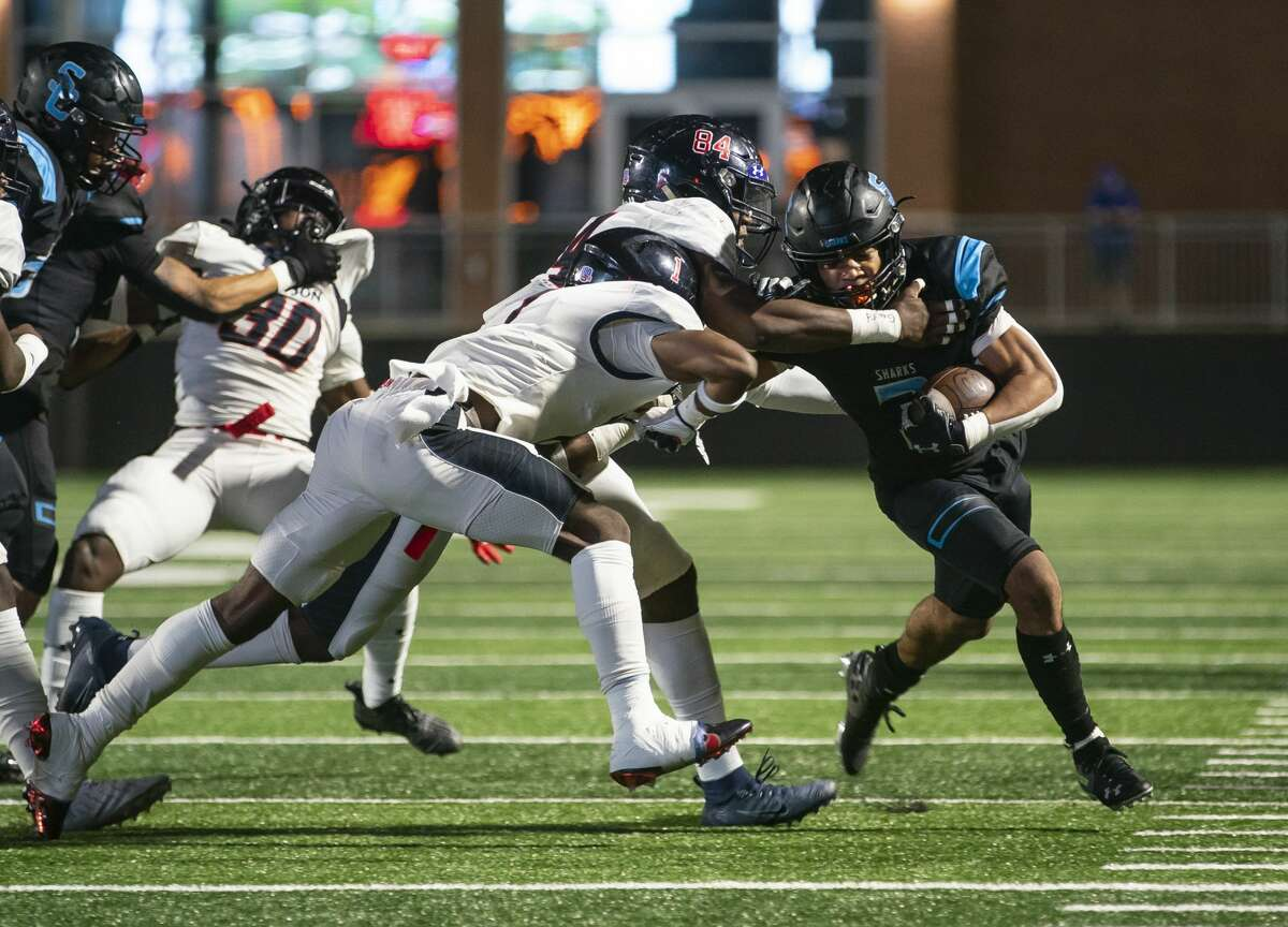 Shadow Creek's Isaiah Harper is pushed out of bounds during the first quarter of the Shark's game against Shadow Creek High School and Dawson High School on Friday, Nov. 20, 2020, at Freedom Field in Arcola, TX.