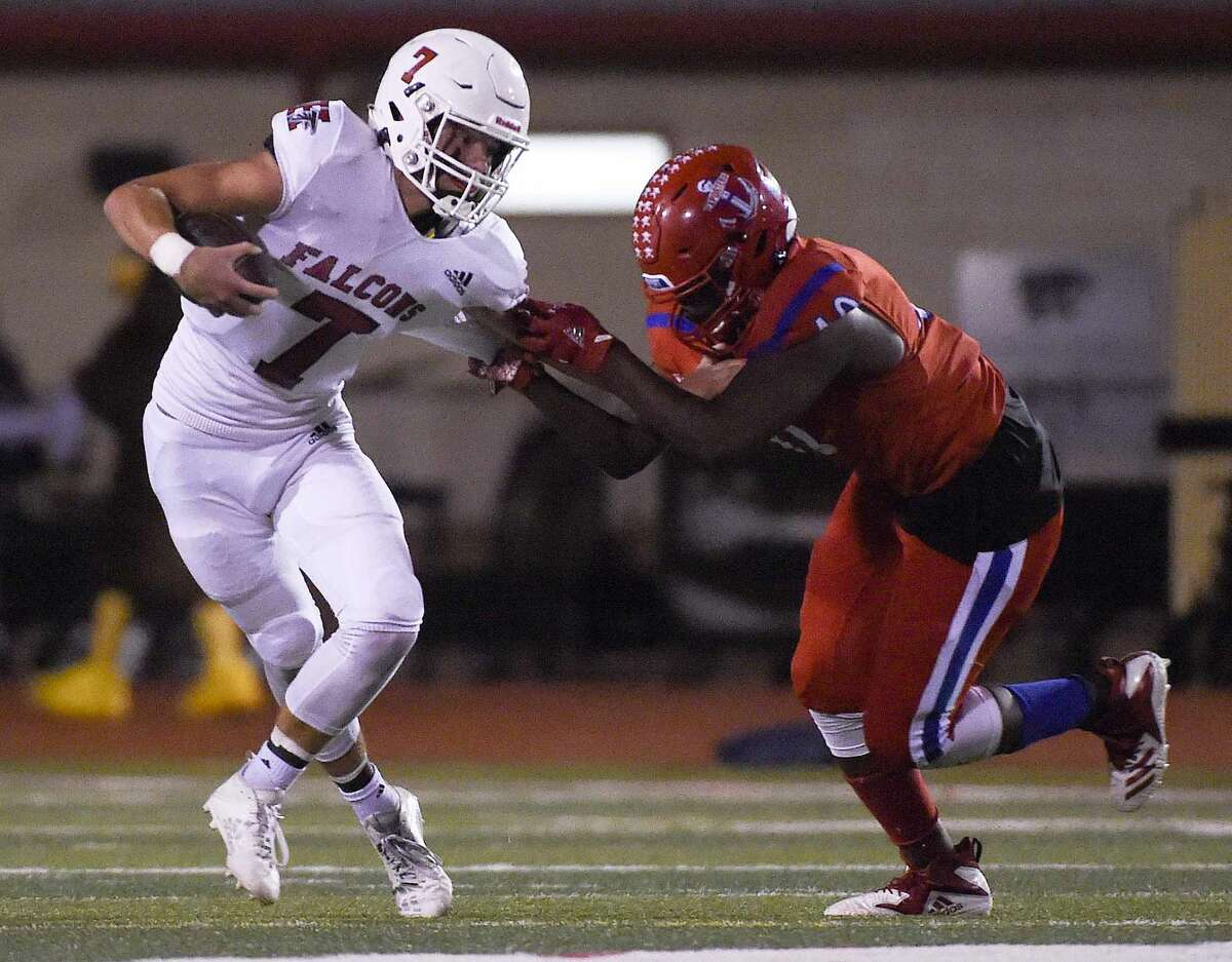 Huffman quarterback Luke Thomas (7) is sacked by Brazosport defensive lineman Jackson Inoisse during the first half of a 4A Division I Region III high school football playoff game, Friday, Nov. 20, 2020, in Splendora, TX.