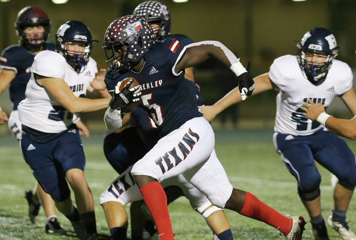 Wimberley's Moses Wray (05) forges ahead for yards against Hondo during their second round high school playoff football game at Southwest Legacy Stadium on Friday, Nov. 20, 2020.