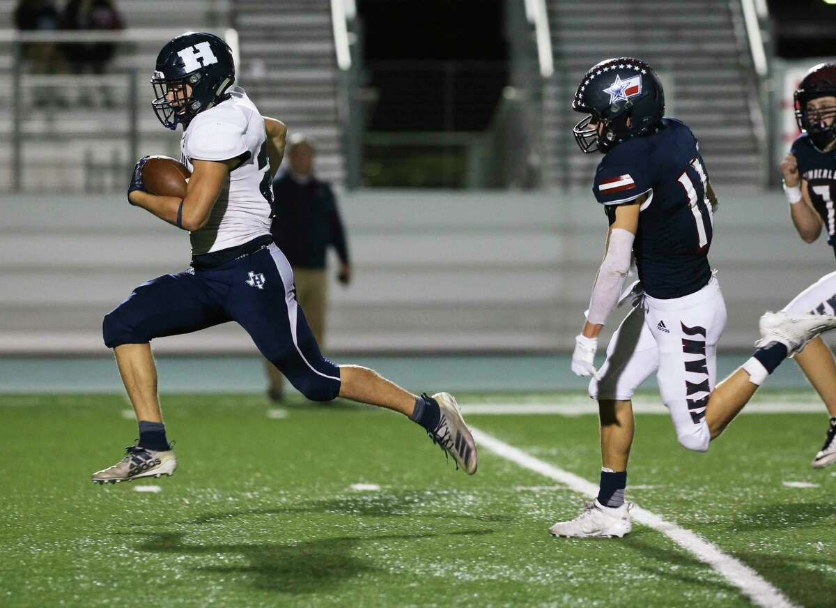 Hondo's Trey Dickens (left) sprints away from Wimberley's Nathan Simpson (11) to score a 53-yard touchdown in the second half of their second round high school playoff football game at Southwest Legacy Stadium on Friday, Nov. 20, 2020.