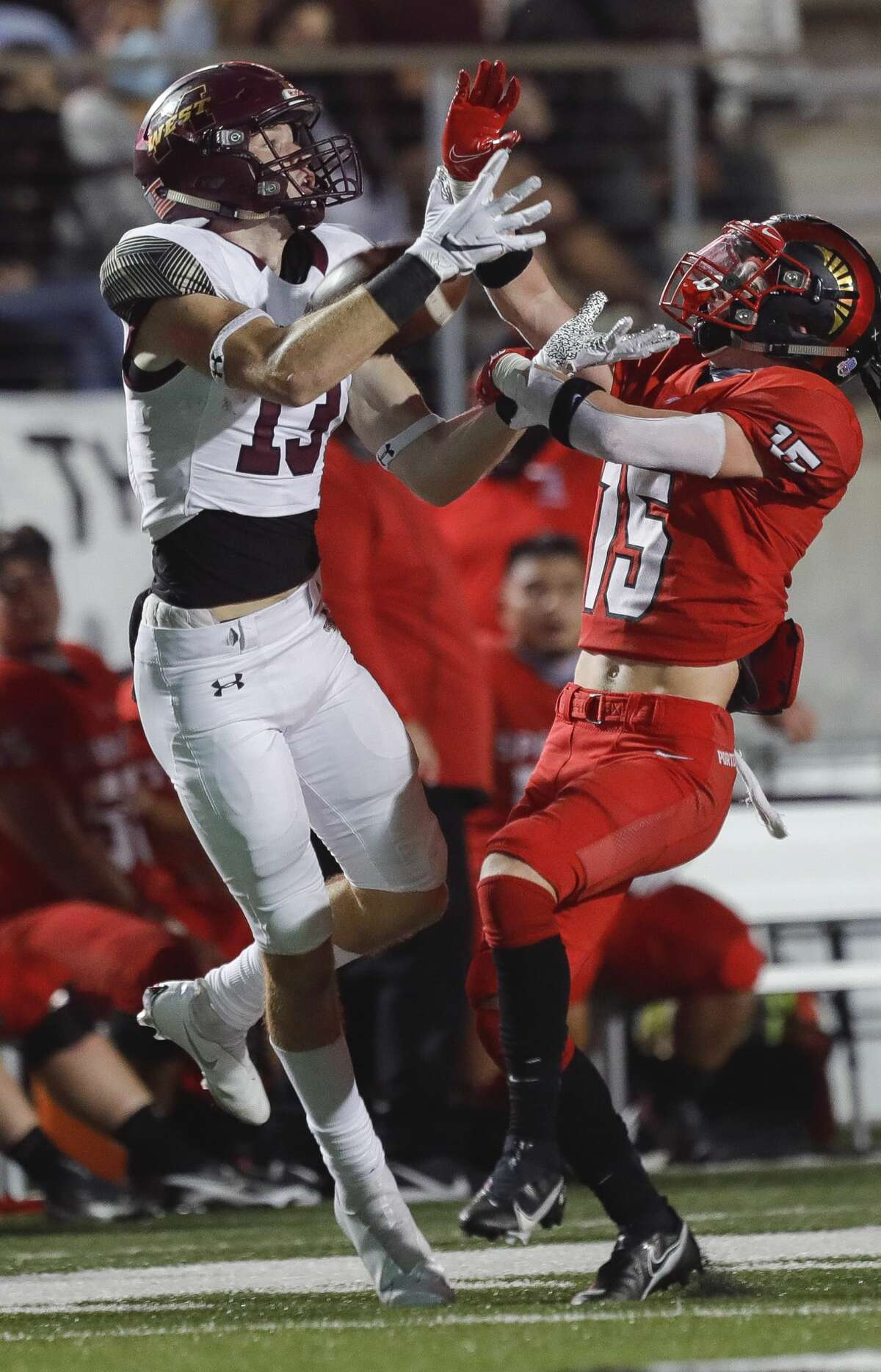 Porter defensive back Isaac Roberts (15) breaks up a pass intended for Magnolia West wide receiver Jeffrey Krop (13) during the fourth quarter of a District 8-5A high school football game at Randall Reed Stadium, Friday, Nov. 20, 2020, in New Caney. Porter defeated Magnolia West 44-35.
