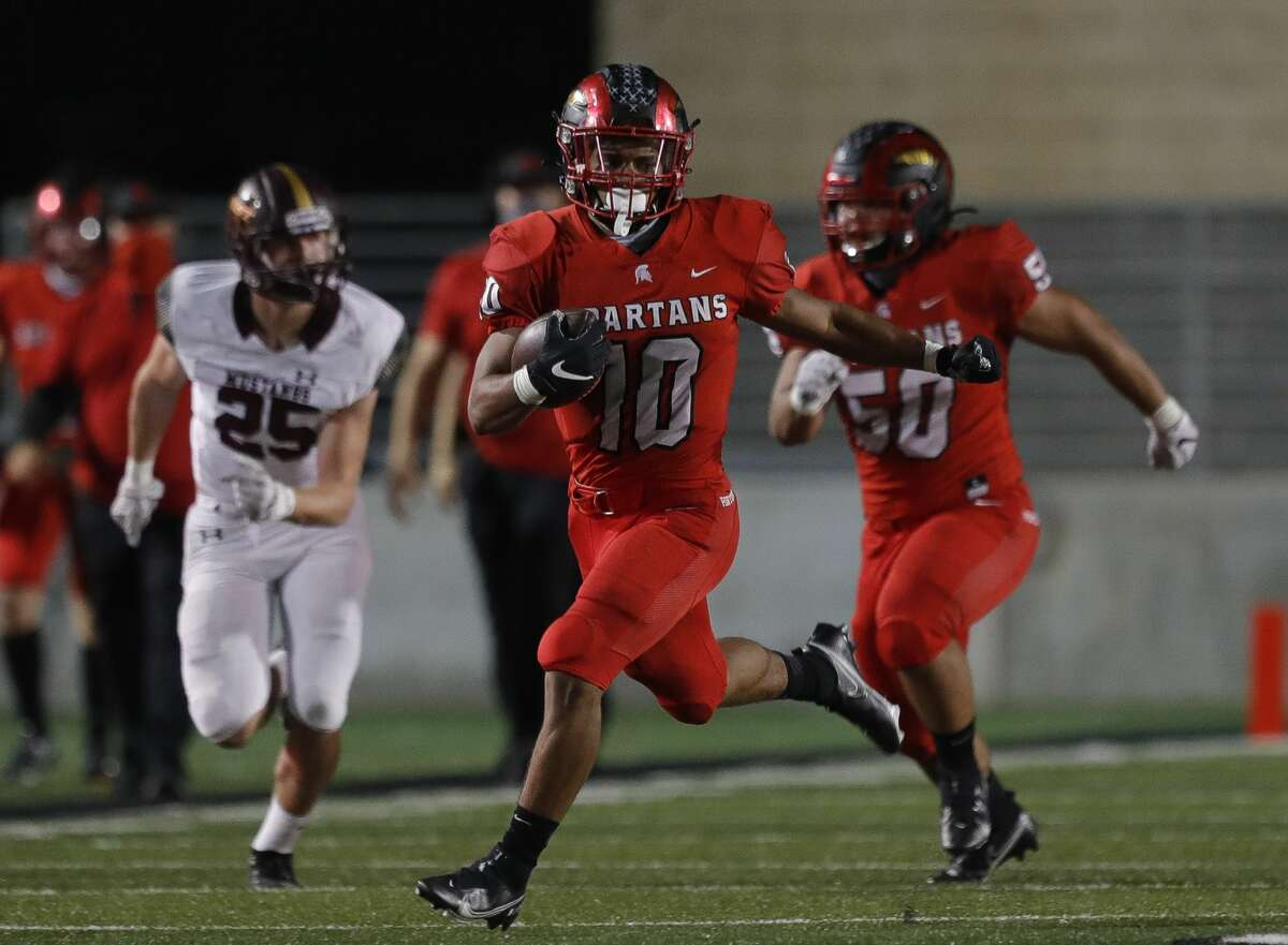 Porter running back Joshua Evans-Pickens (10) runs for a 49-yard gain during the second quarter of a District 8-5A high school football game at Randall Reed Stadium, Friday, Nov. 20, 2020, in New Caney.