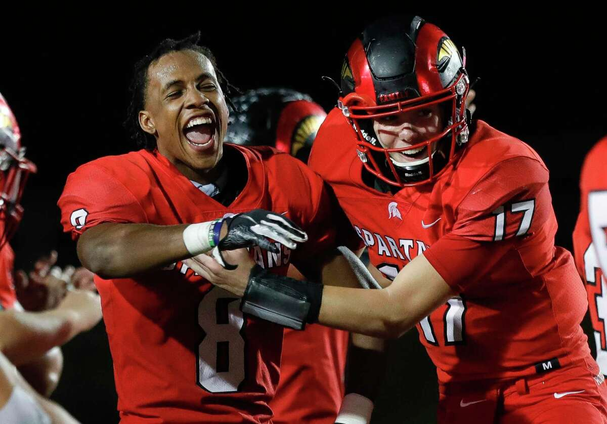 Porter quarterback Jace Russell (17) celebrates with Porter wide receiver Jaylynn Briley (8) after hanging onto a 44-35 win over Magnolia West during a District 8-5A high school football game at Randall Reed Stadium, Friday, Nov. 20, 2020, in New Caney.