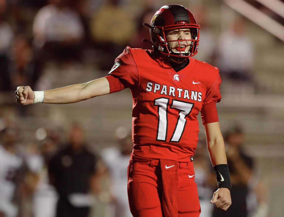 Porter quarterback Jace Russell (17) reacts after a 6-yard touchdown from running back Joshua Evans-Pickens during the first quarter of a District 8-5A high school football game at Randall Reed Stadium, Friday, Nov. 20, 2020, in New Caney.