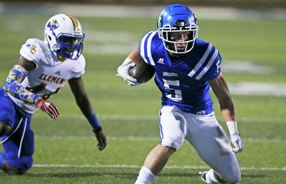 Unicorn running back Ryker Purdy gets away from a tackler and looks upfield as New Braunfels hosts Clemens at Unicorn Stadium on Nov. 20, 2020 Photo: Tom Reel, San Antonio Express-News / Staff Photographer / **MANDATORY CREDIT FOR PHOTOG AND  SAN ANTONIO EXPRESS-NEWS/NO SALES/MAGS OUT/TV