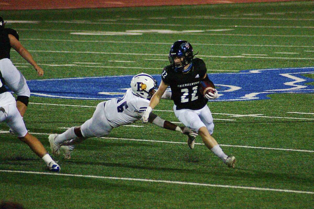Friendswood's Noah Palitz (22) tries to beat the tackle of Ball High's Rod'Dre Butler (25) Friday, Nov. 20 at Friendswood High School.