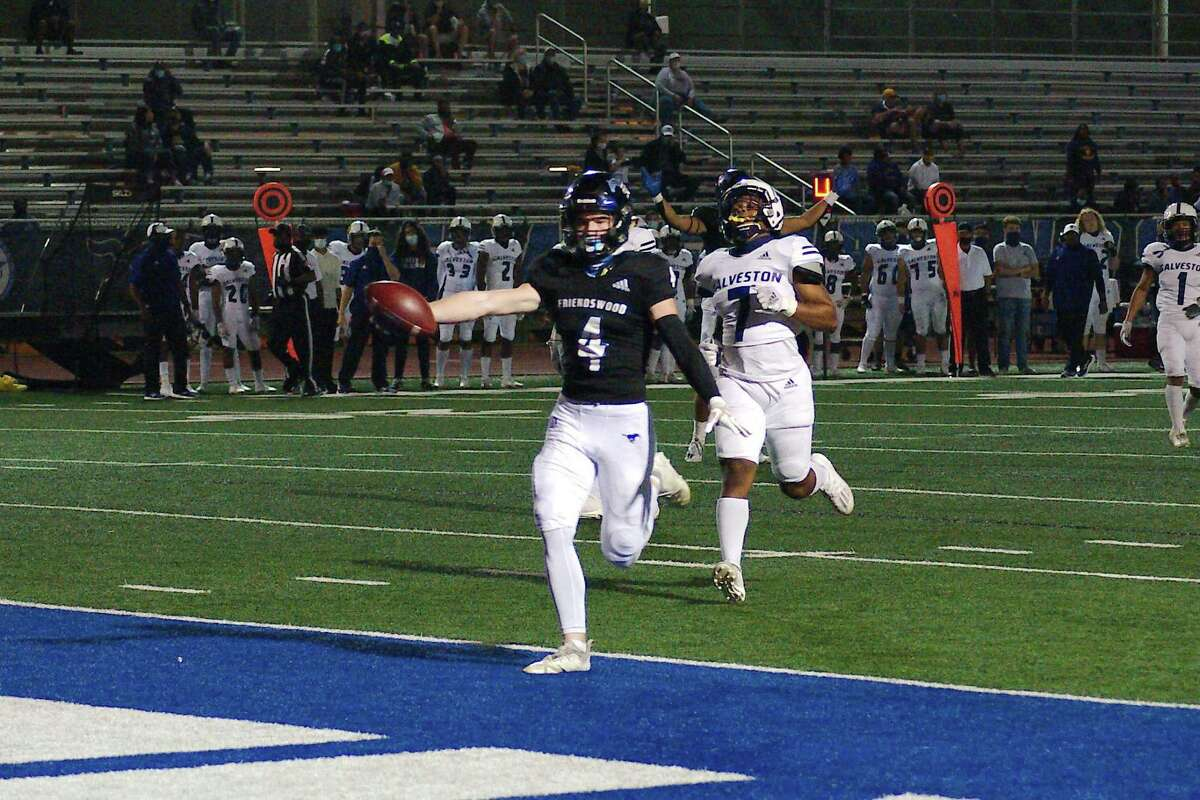 Friendswood's Nolan Smith (4) sprints into the end zone past Ball High's Anthony Black (7) Friday, Nov. 20 at Friendswood High School.