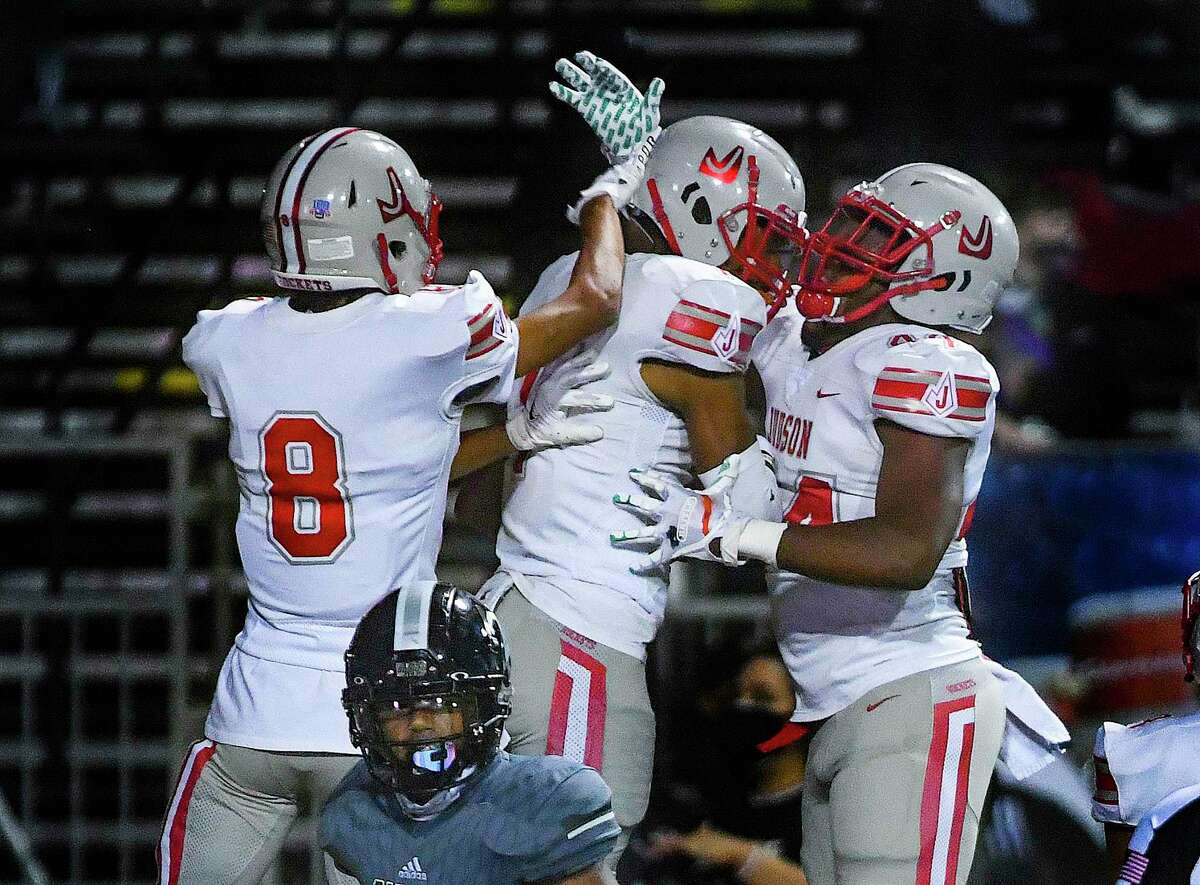 Judson Rockets quarterback Michael Burroughs, middle, celebrates with teammates Andre Jones, left, and Donnie Moody, right, after scoring on a first-half run against the Steele Knights during high school football action at Lehnhoff Stadium in Schertz on Friday, Nov. 20, 2020.