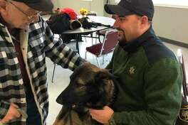 Jo Speiser greets the new Sheriff K9, Faro, during a monthly Police Talk presentation. (Courtesy Photo)