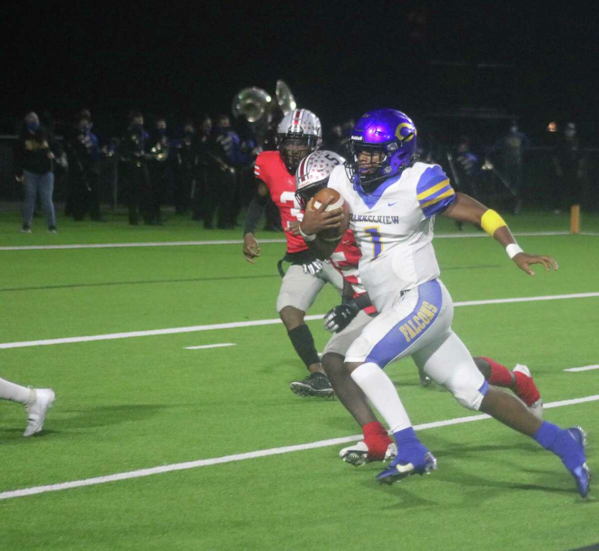 With no time left on the first-half clock, Channelview's Demetrius Charles scores on an 18-yard run that got the Falcons within 16-14 for halftime. Charles threw for 275 yards and four touchdowns by night's end.