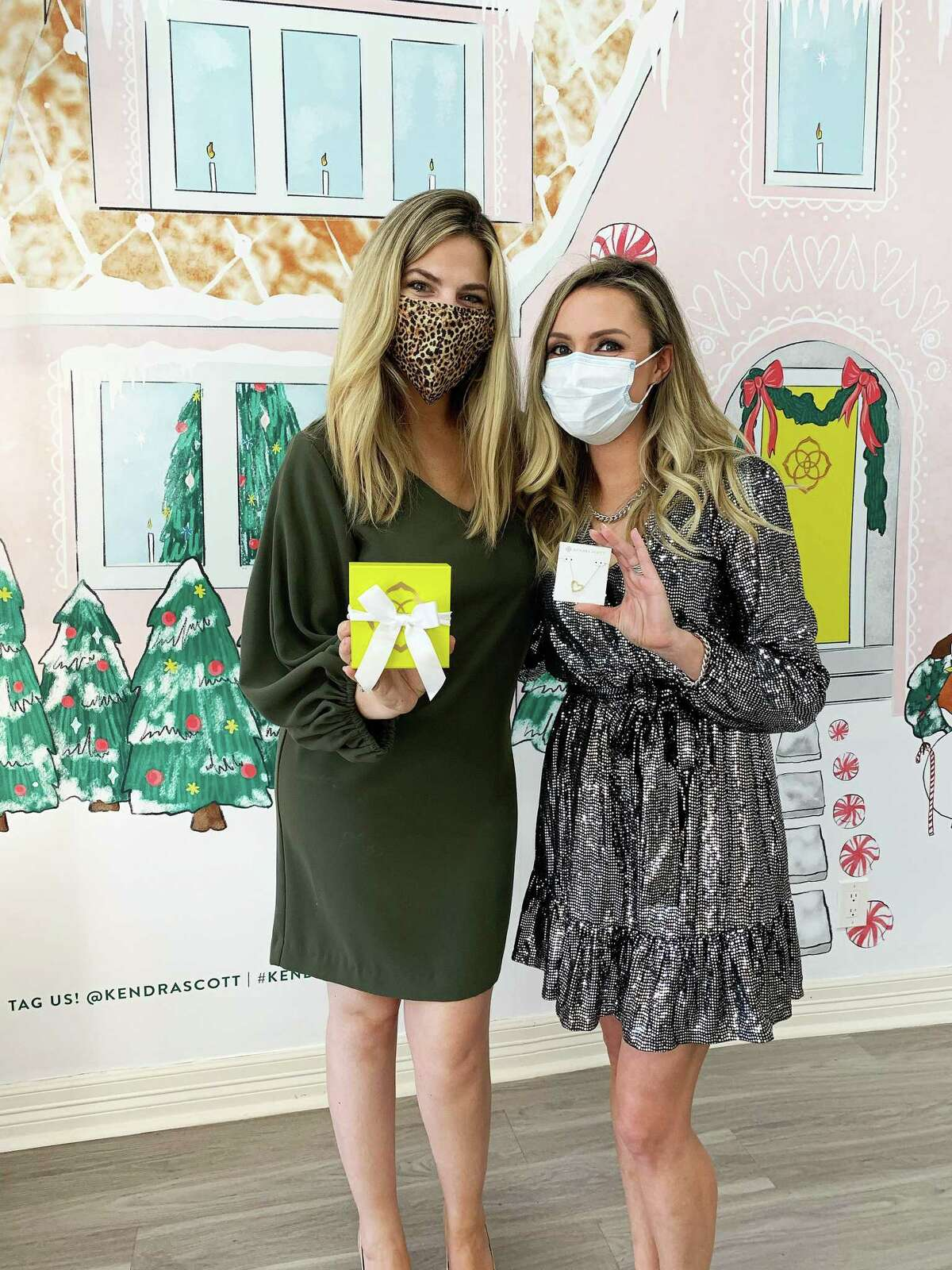 Hilary Wetmore of Kendra Scott (left) and Lindsey McConathy of Caldwell Companies show off some of the latest gifts at the Cypress store.