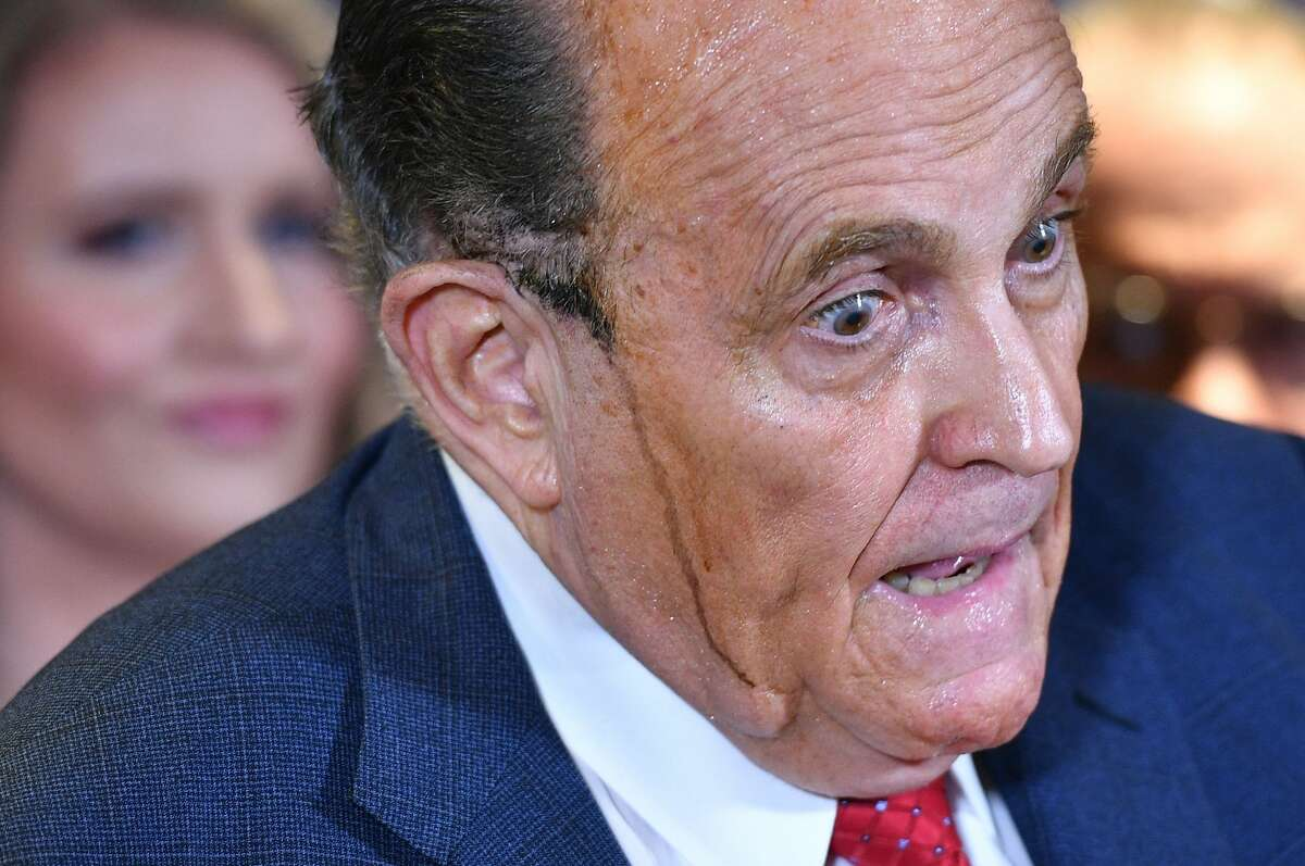 TOPSHOT - Trump's personal lawyer Rudy Giuliani perspires as he speaks during a press conference at the Republican National Committee headquarters in Washington, DC, on November 19, 2020. (Photo by MANDEL NGAN / AFP) (Photo by MANDEL NGAN/AFP via Getty Images)