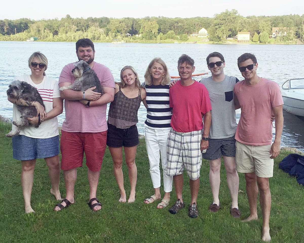 The Predmore family in a 2019 photo at Ballston Lake, from left, Kelly Griffn Predmore, Sam Predmore, Elizabeth Predmore, Ellen Predmore, Dan Predmore, Sean Singer and Zach Predmore. (Provided)