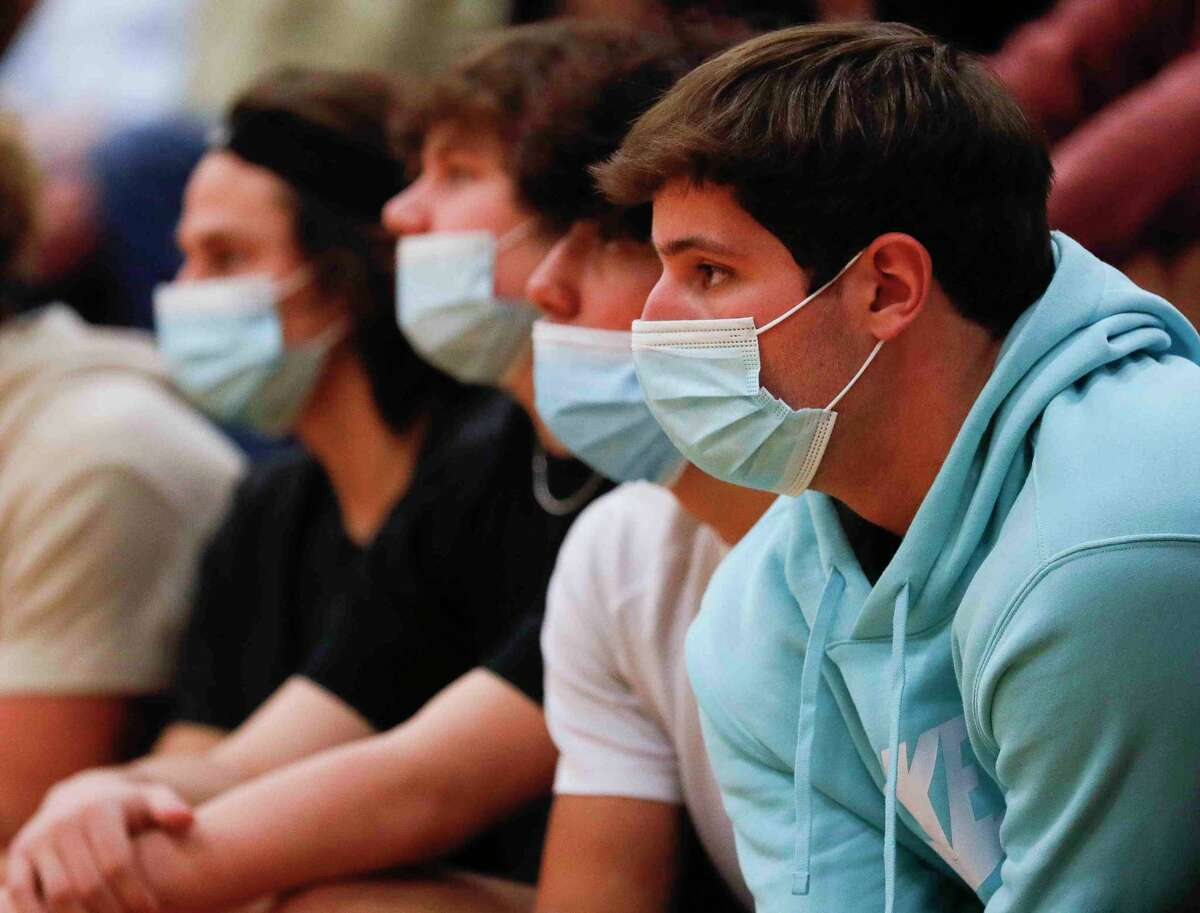 Magnolia students wears face masks as they watch the first set of a District 19-5A high school volleyball match at Magnolia High School, Tuesday, Oct. 6, 2020, in Magnolia.