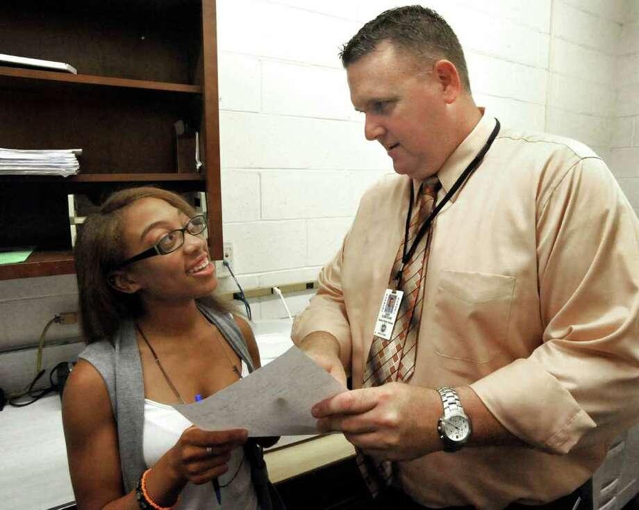 Freshman Academy student Treja Landon gets advice from Dan Donovan, principal of the Freshman Academy at Danbury High School, on the first day, Thursday, Sept. 2, 2010. Photo: Michael Duffy / The News-Times