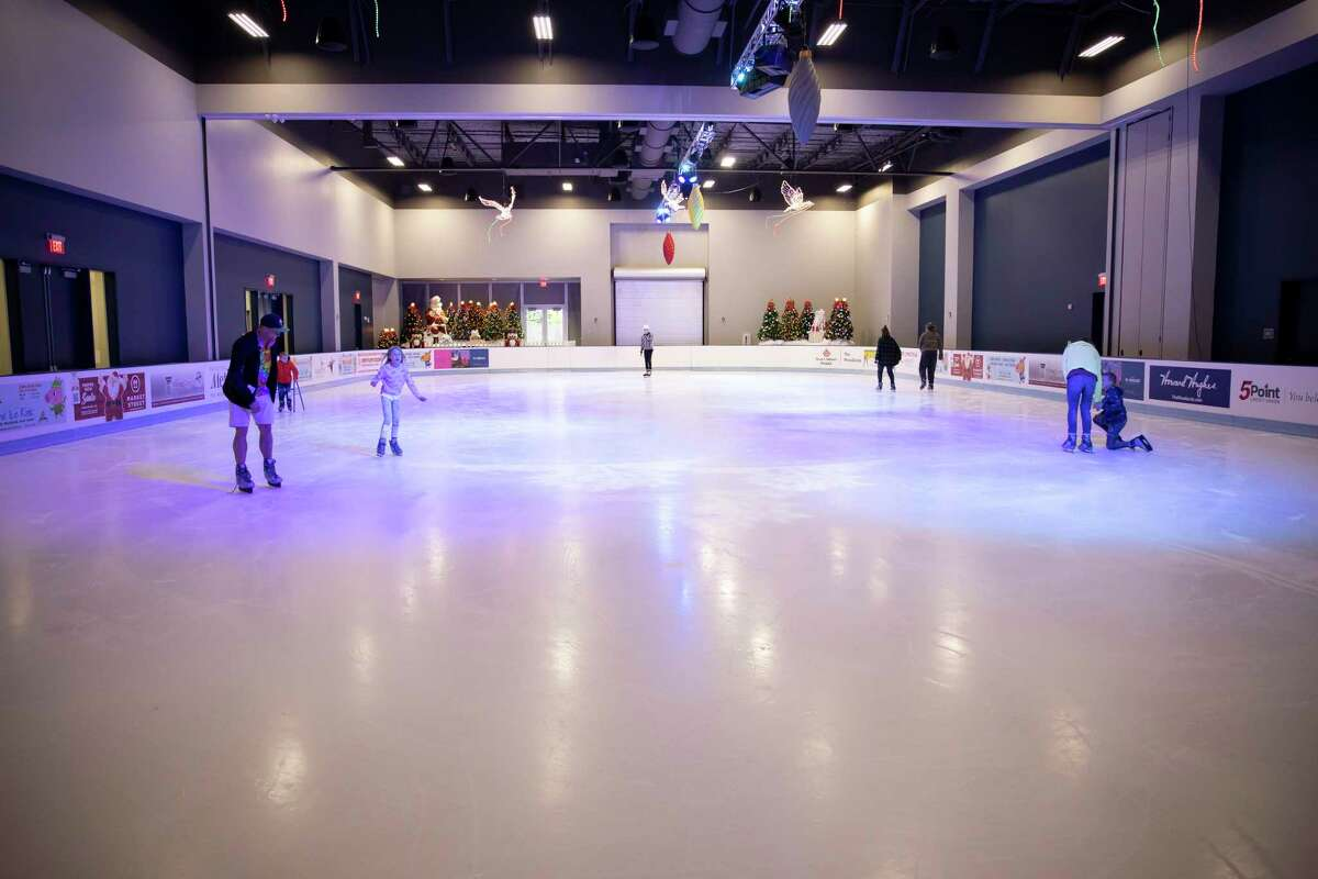 Families and friends skate inside The Ice Rink at The Woodlands Town Center, Friday, Nov. 20, 2020. The facility has adopted procedures such as more stringent cleaning procedures, provide social distancing and requiring temperature checks once they enter the facility.