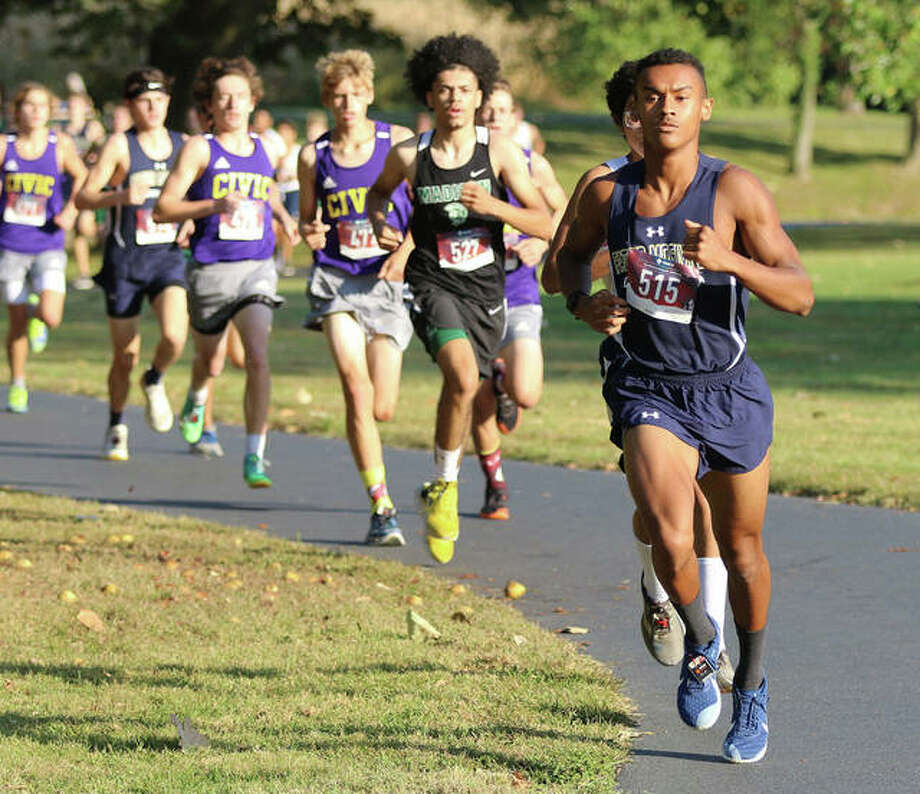 Father McGivney senior Tyler Guthrie leads a line of runners in the opening quarter-mile of his victory at the Madison County Small-Schools Meet on Oct. 6 at Belk Park in Wood River. Guthrie has signed to run college cross country and track at SIUE. Photo: Greg Shashack / The Telegraph
