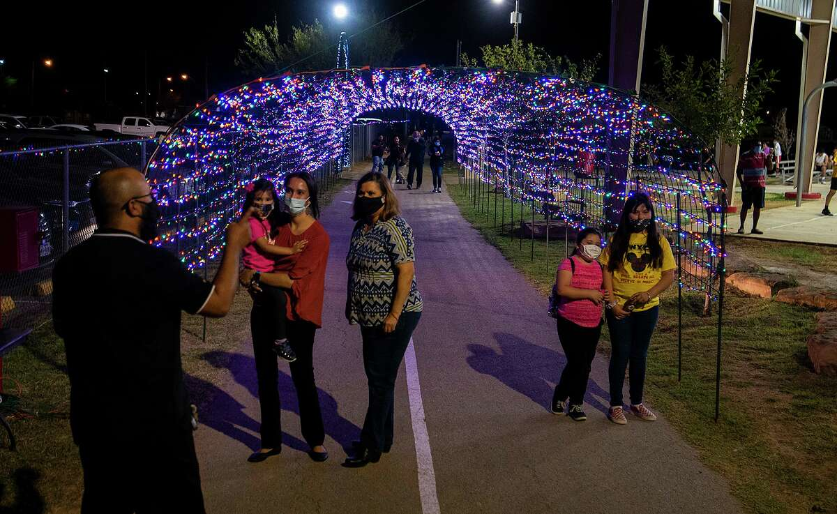 """Christmas light displays like the one at Jovita Idar's """"El Progreso"""" Park cut back hours to comply with the city's curfew."""