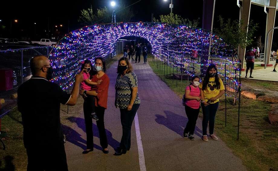 "Christmas light displays like the one at Jovita Idar's ""El Progreso"" Park cut back hours to comply with the city's curfew. Photo: Danny Zaragoza /Laredo Morning Times"