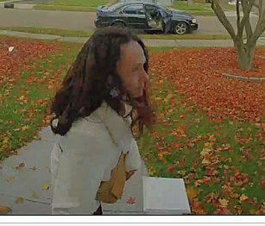East Haven police are asking the public's help in identifying a woman suspected of stealing packages from several houses on Thursday, Nov. 19, 2020 Capt. Joseph M. Murgo said. The suspect was captured on video surveillance pulling up to houses in an early 2000s black or dark gray Nissan Maxima with a right rear spare tire Photo: East Haven Police Photo