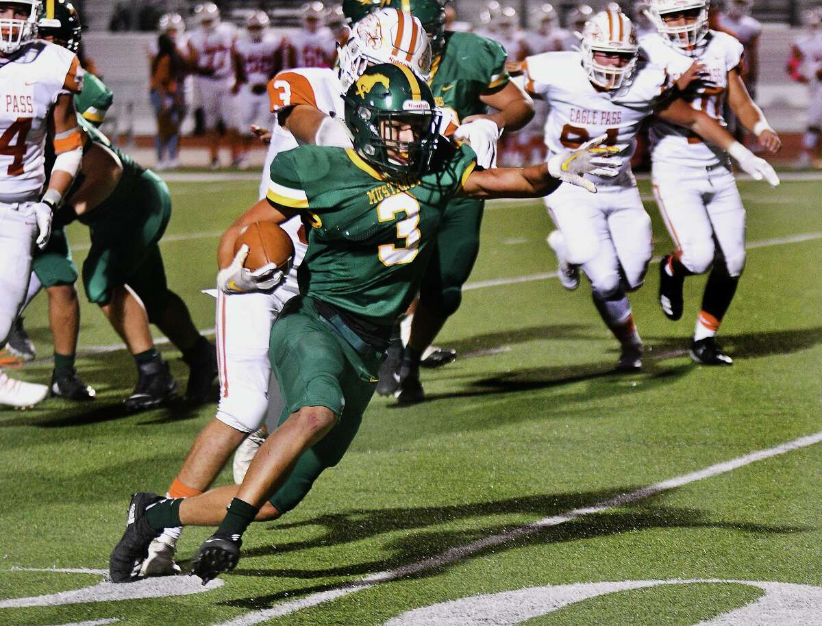 Ricky Navarro eludes a defender as he carries the ball for the Nixon Mustangs as they played Eagle Pass at Shirley Field, Friday, November 6, 2020.