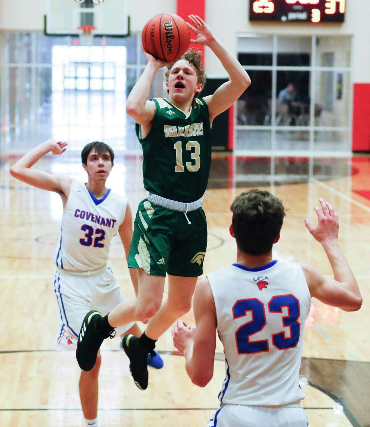The Woodlands Christian Academy point guard Austin Benigni (13), shown here last season, scored 23 points against St. Pius X on Saturday, Nov. 21, 2020 in The Woodlands.