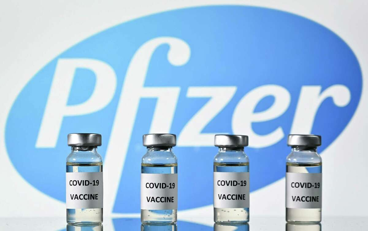This file photo illustration picture shows vials with Covid-19 Vaccine stickers attached, with the logo of US pharmaceutical company Pfizer.