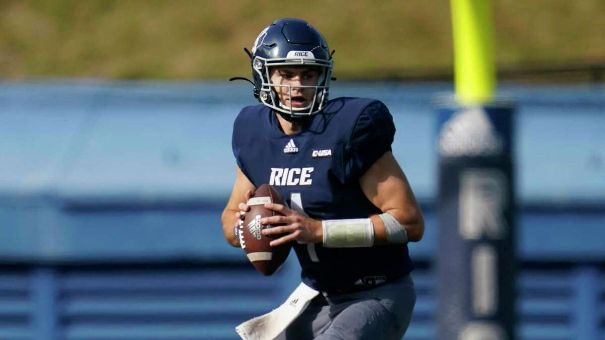 Rice quarterback Mike Collins looks to pass against Middle Tennessee in October.