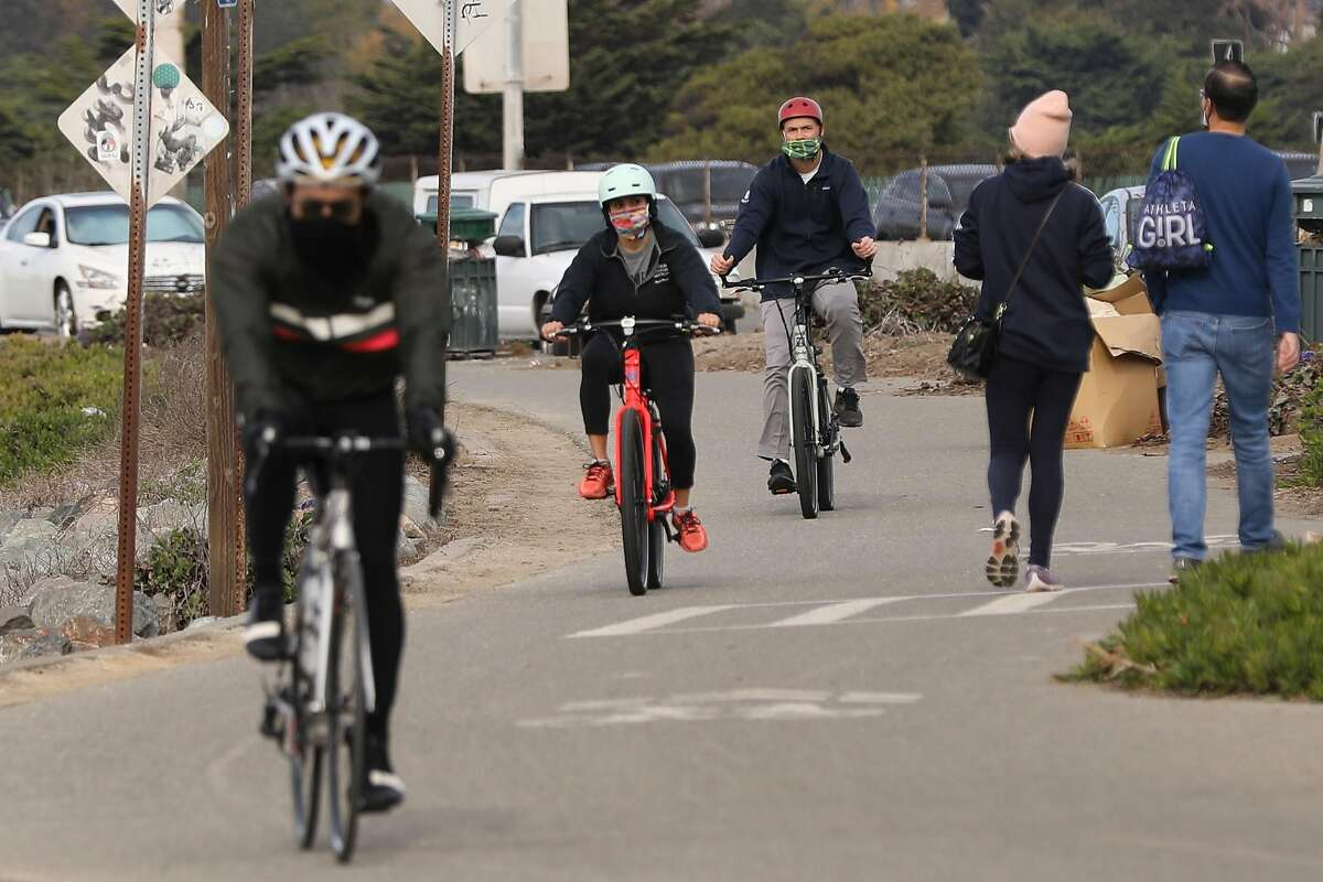Cyclists along Frontage Road in Emeryville take advantage of Saturday's pleasant conditions.