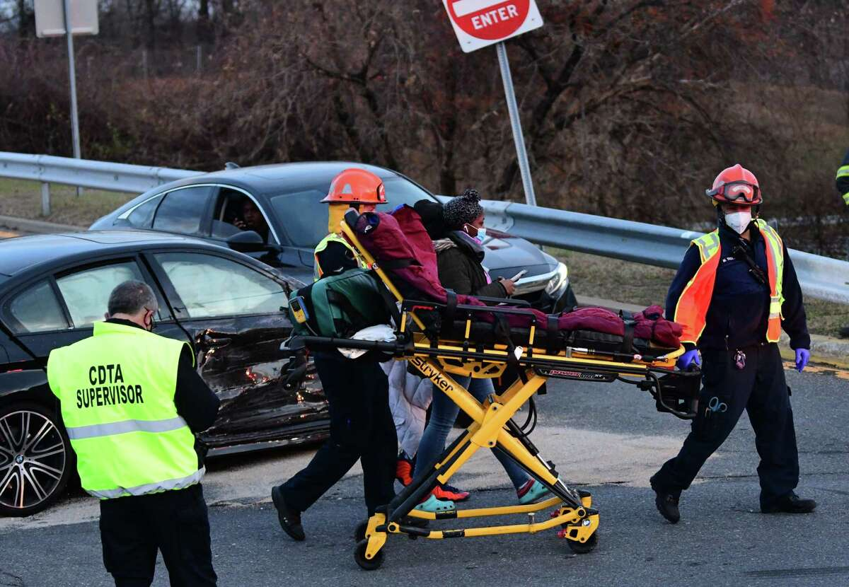 A person is seen being taken to an ambulance at the scene of a multi-car accident at the I-87 ramp at Crossgates Mall on Saturday, Nov. 21, 2020 in Albany, N.Y. A CDTA bus was involved. (Lori Van Buren/Times Union)
