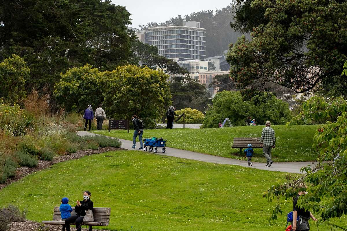 Visitors wear masks while socially distancing at the San Francisco Botanical Garden inside Golden Gate Park in June. Low-income families can now visit the garden for free.