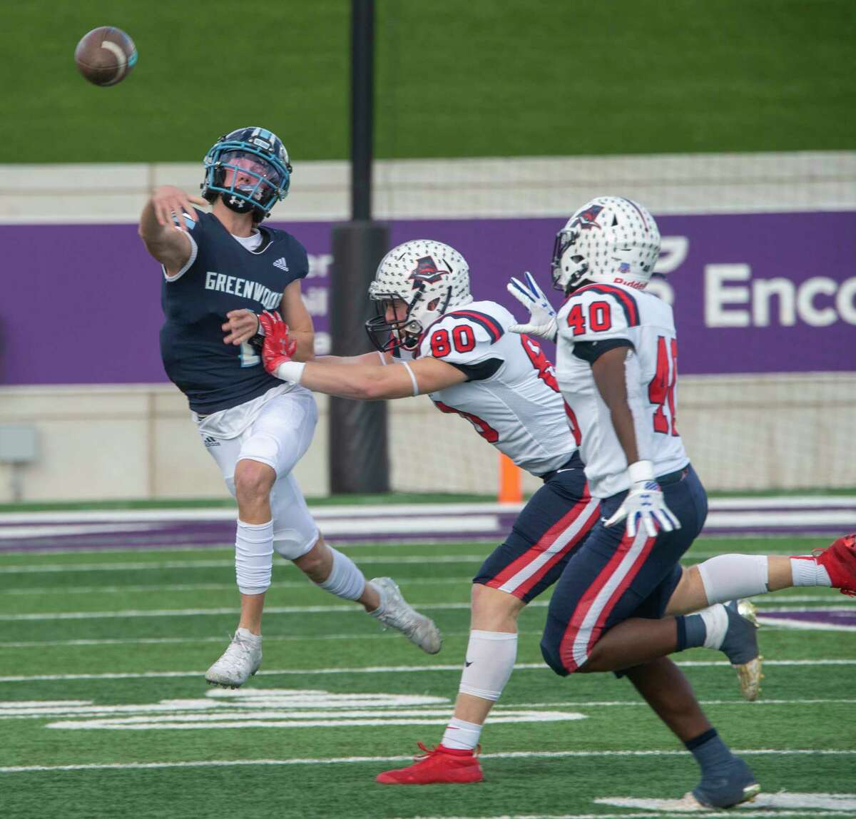 Greenwood's Ty Flowers gets a pass away as Aubrey's Jett Runion chases him out of the pocket 11/21/2020 at Anthony Field on Abilene Christian University campus. Tim Fischer/Reporter-Telegram
