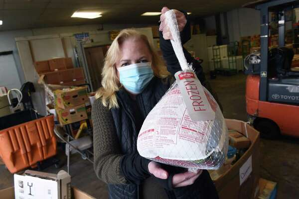 Kate Lombardi, executive director of the Food Bank of Lower Fairfield County, holds a package of frozen turkey breasts which was the only frozen turkey available at the food bank on Oct. 30, 2020. Normally the food bank would have 400-500 frozen turkeys at this time and would distribute around 15,000 turkeys for Thanksgiving.
