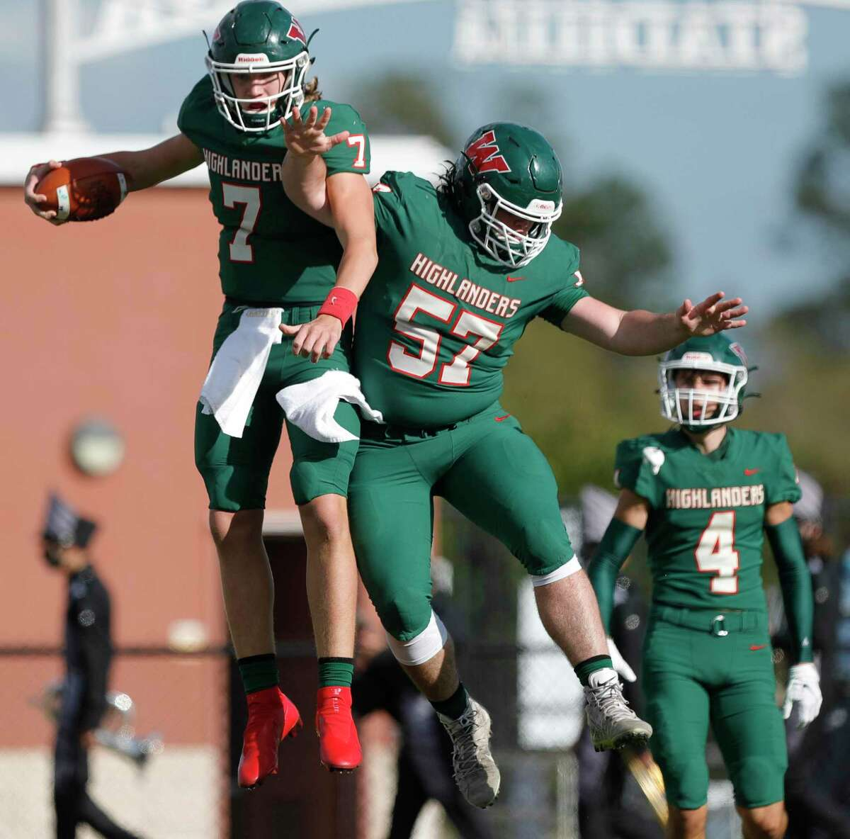 The Woodlands backup quarterback Mabrey Mettauer (7) celebrates with offensive linemen Titan Tucker (57) after running for a 6-yard touchdown during the second quarter of a District 13-6A high school football game at Woodforest Bank Stadium, Saturday, Nov. 21, 2020, in Shenandoah.