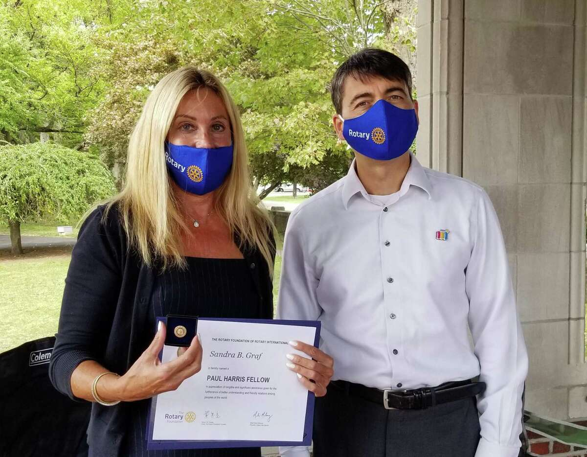 New Canaan resident Sandra Graf has been named a Paul Harris Fellow by the Rotary Club of New Canaan. Graf is pictured here with the President of the Rotary Club of New Canaan Alex Grantcharov.