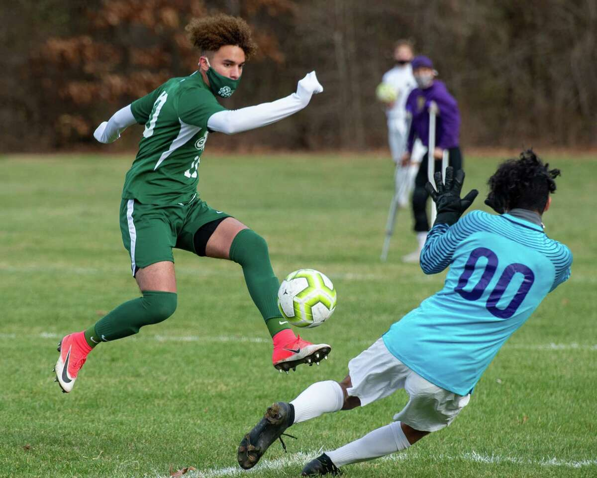 Shenendehowa senior Darien Espinal beats CBA keeper Adrian Torres for a goal during the Suburban Council championship at Shenendehowa High School in Clifton Park, NY, on Saturday, Nov. 21, 2020 (Jim Franco/special to the Times Union.)