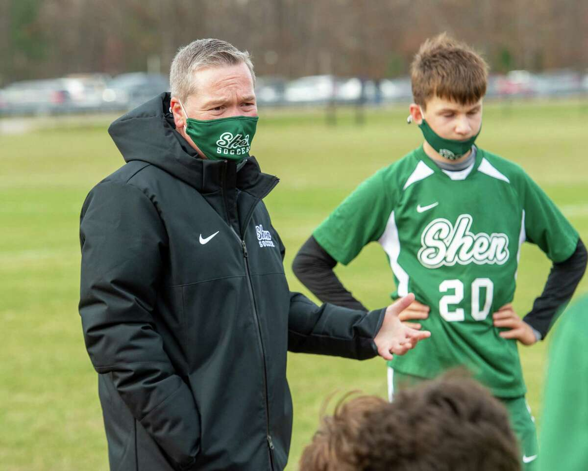 Shen head boys soccer coach Jonathan Bain talks to his team during halftime of the Suburban Council championship against CBA at Shenendehowa High School in Clifton Park, NY, on Saturday, Nov. 21, 2020 and Shen won 3-2 (Jim Franco/special to the Times Union.)
