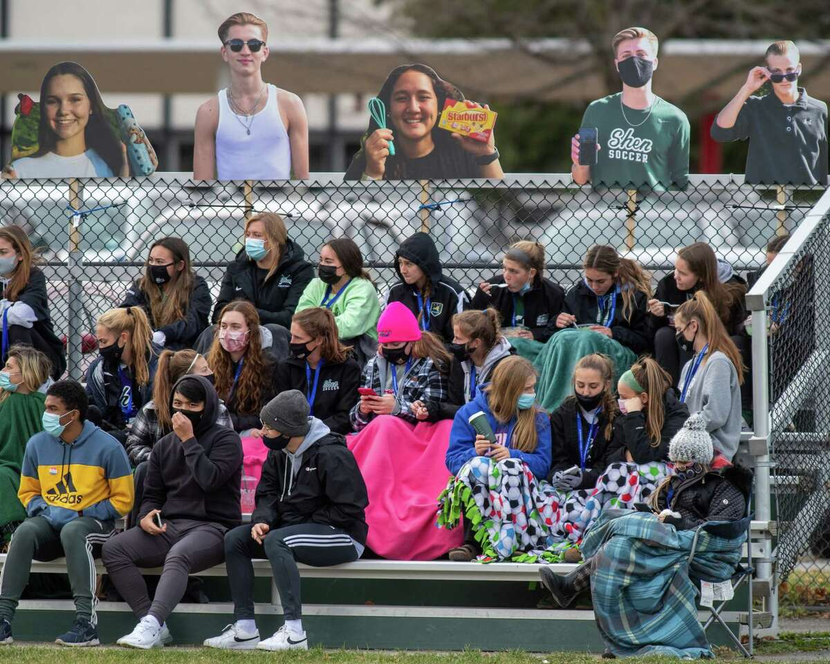 The Shenendehowa girls soccer team watches the boys play in the Suburban Council championship against CBA at Shenendehowa High School in Clifton Park, NY, on Saturday, Nov. 21, 2020, after their championship game against Shaker High School was canceled because of COVID-19 (Jim Franco/special to the Times Union.)