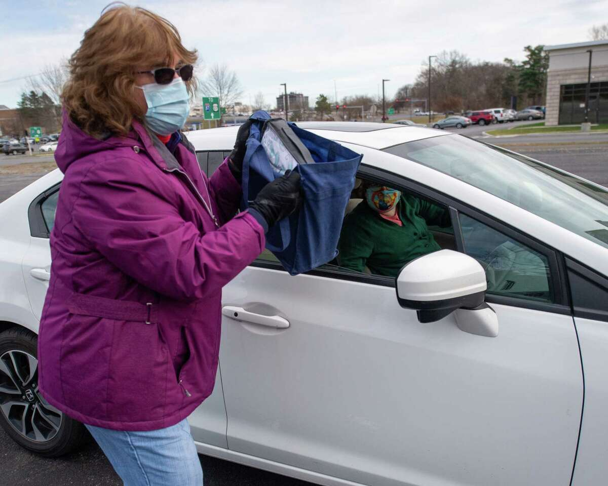 Albany County Department for Children, Youth and Families Commissioner Moira Manning collects donations for the annual Adopt-A-Family campaign during a drive-thru collection event at Crossgates Mall in Guilderland, NY, on Saturday, Nov. 21, 2020 (Jim Franco/special to the Times Union.)